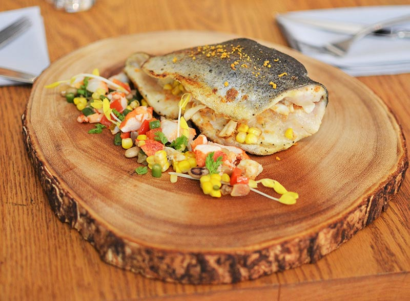Crab-Stuffed Mountain Trout with Preserved Lemon, Corn and Lobster Succotash
